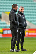 Motherwell FC assistant manager, Keith Lasley (right) speaks with Motherwell FC assistant manager, Chris Lucketti before the SPFL Premiership match between Hibernian FC and Motherwell FC at Easter Road, Edinburgh, Scotland on 27 February 2021.