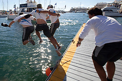 The customary dunking for the skipper and crew after winning the finals of the Argo Group Gold Cup 2010. Hamilton, Bermuda. 10 October 2010. Photo: Subzero Images/WMRT