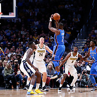 09 November 2017: Oklahoma City Thunder guard Raymond Felton (2) takes a jump shot over Denver Nuggets forward Paul Millsap (4) and Denver Nuggets center Mason Plumlee (24) during the Denver Nuggets 102-94 victory over the Oklahoma City Thunder, at the Pepsi Center, Denver, Colorado, USA.