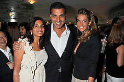 Left to right, DIVIA CADBURY, her brother DINO LALVANI and VANESSA FERNANDEZ at a party to celebrate the launch of Jax Coco - a new soft drink, held at Harvey Nichols 5th Floor Bar, 109-125 Knightsbridge, London on 25th June 2012.