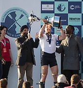 Mortlake/Chiswick, GREATER LONDON. United Kingdom. Oxford University BC, President Michael DI SANTO, lifts the Trophy, after his crew win the 2017 Men's Boat Race, as his OUBC Celebrate, The Championship Course, Putney to Mortlake on the River Thames.<br /> Sunday  02/04/2017<br /> <br /> [Mandatory Credit; Peter SPURRIER/Intersport Images]
