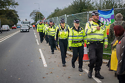 © Licensed to London News Pictures. 09/10/2017. Lancashire, UK.  Police arrive to remove protesters from the Anti-Fracking Demonstration on Preston New Road Lancashire at the entrance to Cuadrillas Hydraulic fracking site. The Demo brought together activists from Greenpeace, The Green Party and the local community to protest against the drilling taking place at the site.  Photo credit: Steven Speed/LNP