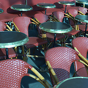 empty cafe tables and chairs in paris create a pretty pattern