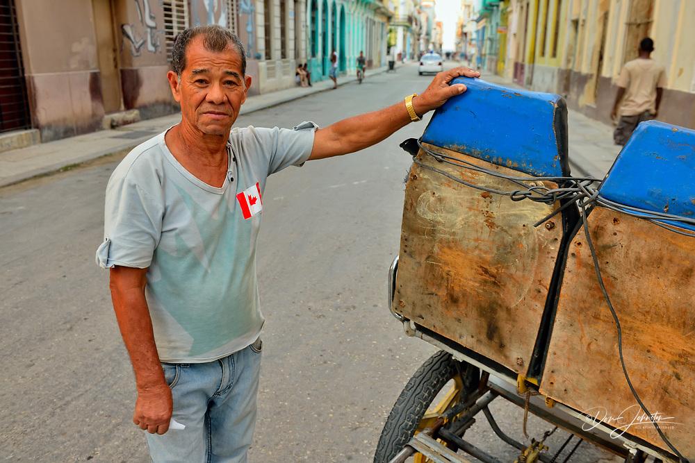 Street photography in central Havana- Bicycle taxi driver with Canadian flag, La Habana (Havana), Habana, Cuba