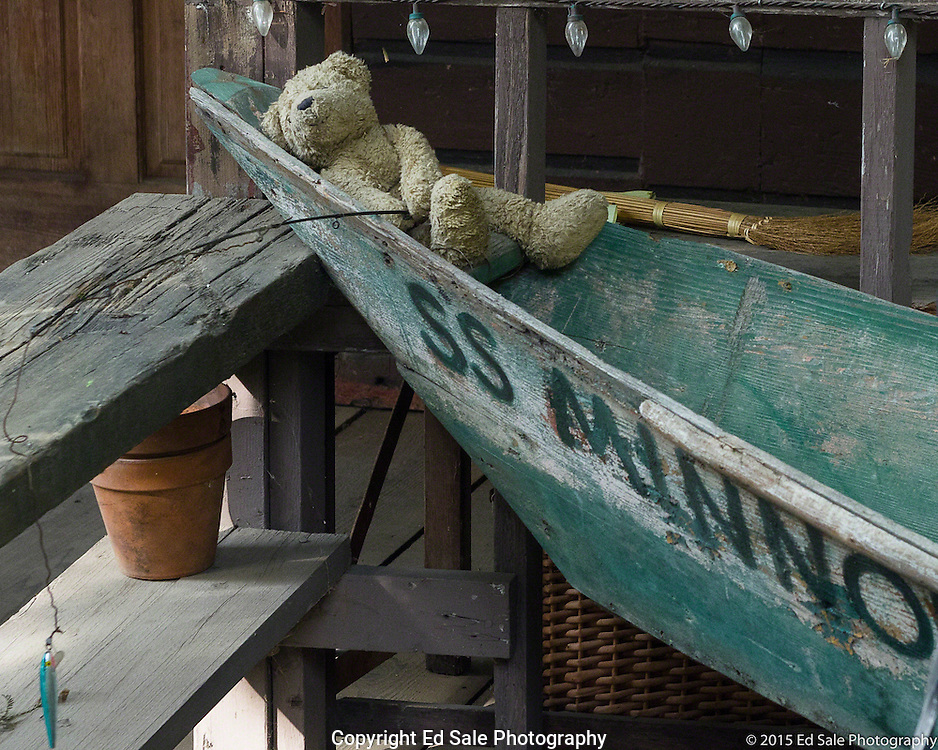 Stuffed bear fishing from a row boat on a lazy summer day at The Art Shack in Locke, California