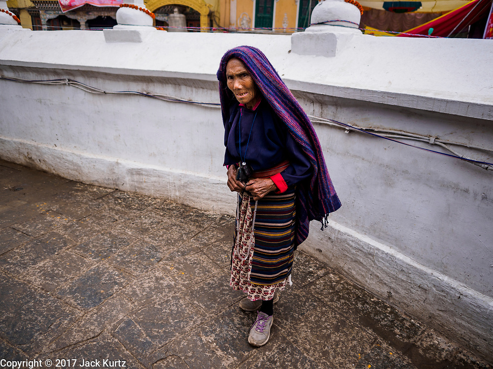 10 MARCH 2017 - KATHMANDU, NEPAL: Women at Boudhanath Stupa in Kathmandu. Boudhanath Stupa, the most important Buddhist site in Nepal and a popular tourist attraction, was consecrated Tuesday in a ceremony attended by thousands of Buddhist monks and Buddhist people from Nepal and Tibet. The stupa was badly damaged in the 2015 earthquake that devastated Nepal. The stupa, which reopened in November 2016, was repaired in about 18 months. The repair was financed by private donations raised by international Buddhist organizations.    PHOTO BY JACK KURTZ