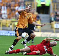 Photo: Paul Greenwood. <br />Wolverhampton Wanderers v Watford. Coca Cola Championship. 11/08/2007. <br />Watford's Gavin Mahon takes the ball from Wolves Michael Kightly with a sliding tackle