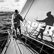 Leg 6 to Auckland, day 18 on board MAPFRE, sunrise, Louis Sinclair with his shadow at the bow during a pilling. 23 February, 2018.