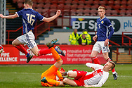 Scotland Keeper Cieran Slicker (Mancester City) bravely goes to ground during a challenge from Daniel Dudzinski during the U17 European Championships match between Scotland and Poland at Firhill Stadium, Maryhill, Scotland on 26 March 2019.