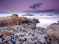 Sunset along the coast of Pebble Beach.