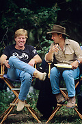 """BOZEMAN, MT - AUGUST:  Robert Redford and Philip Caputo discuss the filming of """"A River Runs Though It"""" while on set in 1991. (Photo by John Kelly/Getty Images)"""