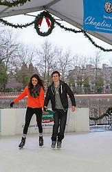 North America, United States, Washington, Bellevue, couple skating in Magic Season Ice Arena, MR, PR