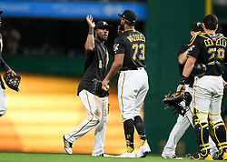 Jun 15, 2018; Pittsburgh, PA, USA; Pittsburgh Pirates center fielder Starling Marte (6) celebrates with Pittsburgh Pirates relief pitcher Felipe Vazquez (73) after beating the Cincinnati Reds at PNC Park. Mandatory Credit: Ben Queen-USA TODAY Sports