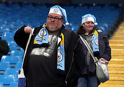 """Manchester City fans in the stands wearing santa hats during the Premier League match at the Etihad Stadium, Manchester. PRESS ASSOCIATION Photo. Picture date: Saturday December 16, 2017. See PA story SOCCER Man City. Photo credit should read: Martin Rickett/PA Wire. RESTRICTIONS: EDITORIAL USE ONLY No use with unauthorised audio, video, data, fixture lists, club/league logos or """"live"""" services. Online in-match use limited to 75 images, no video emulation. No use in betting, games or single club/league/player publications."""