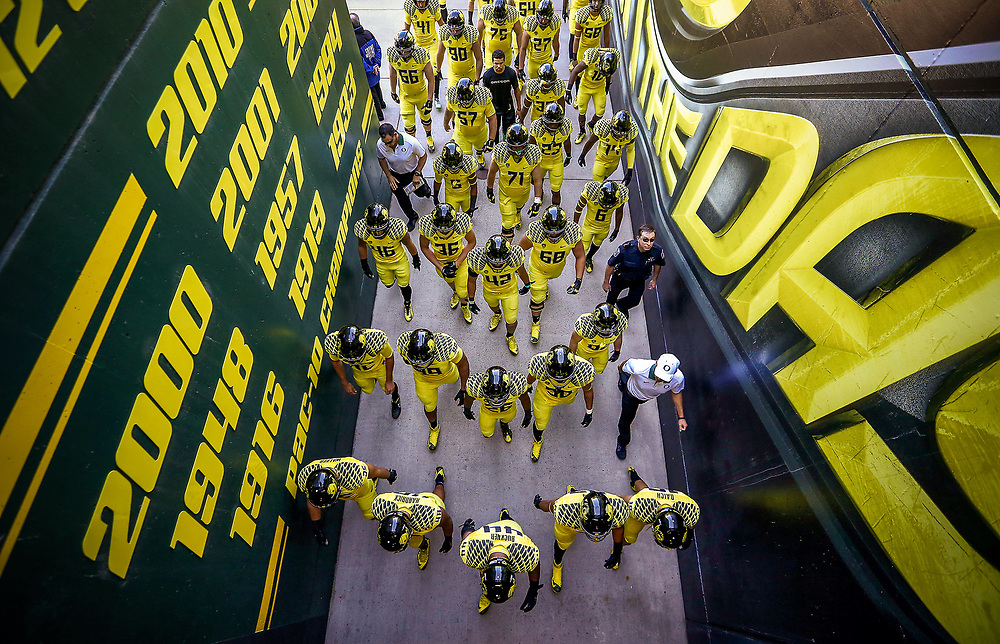 The Oregon football team walks towards the field before the start of an NCAA college football game against Georgia State, Saturday, Sept. 19, 2015, in Eugene, Ore. (AP Photo/Ryan Kang)
