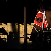 The late afternoon light shines on the stables during night horse racing at Canterbury race course, Sydney, Australia