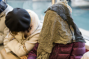 commuter covering her face to get some sleep in the train Tokyo Japan