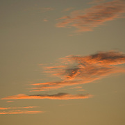 Minimalist view of orange clouds against sunset sky