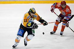 Florian Iberer of Graz vs Rok Ticar of Acroni Jesenice during ice hockey match between HK Acroni Jesenice and  Moser Medical Graz 99ers in 24th Round of EBEL league, on December 3, 2010 in Arena Podmezakla, Jesenice, Slovenia.  (Photo By Vid Ponikvar / Sportida.com)