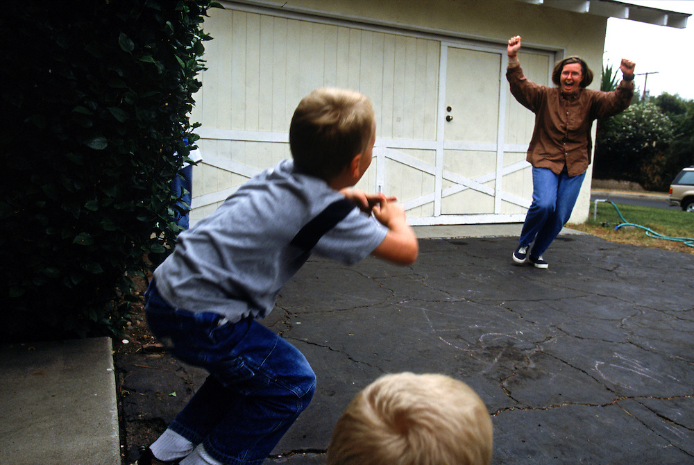 Jeanne Smith celebrates after she and Bryce beat Andrew and Trevor during a game of handball against the garage during Physical Education time.