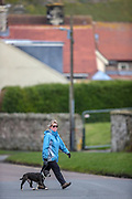 People are seen walking in Bamburgh centre on Wednesday, March 17, 2021. Bamburgh is home to the most important Anglo-Saxon archaeological sites in the world, the Bamburgh Castle. (Photo/ Vudi Xhymshiti)