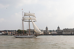 © Licensed to London News Pictures. 15/06/2016. LONDON, UK.  The historic tall ship, J R Tolkien is seen passing the Old Royal Naval College on the River Thames in Greenwich. The Sail Royal Greenwich Tall Ship Festival runs until this Sunday, 18th Septmeber.  Photo credit: Vickie Flores/LNP
