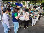 30 MARCH 2014 - BANGKOK, THAILAND:    Voters line up at the polling place at Wat That Thong in Bangkok. Thais voted Sunday to elect 77 senators to the 150-seat Senate. The other 73 senators are appointed by judges and senior officials from agencies such as the National Anti-Corruption Commission (NACC), members of an establishment whom government supporters see as viscerally anti-Thaksin. The government of Yingluck Shinawatra tried to make the senate a fully elected body. That effort was one of the sparks that set off the latest rounds unrest that started in November.   PHOTO BY JACK KURTZ