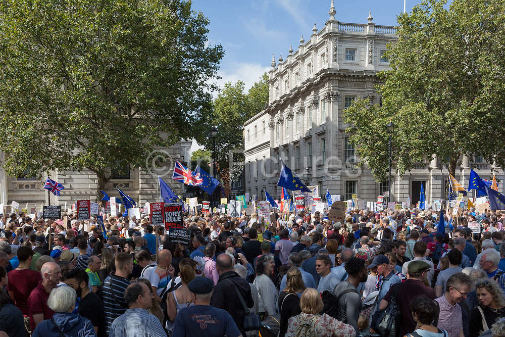 Pro-EU Remain protesters march to Stop the Coup in Whitehall, near Downing Street, at the end of a week that saw Prime Minister Boris Johnson ask Queen Elizabeth for permission to suspend prorogue the British Parliament during the final stages of his Brexit negotiations with the European Union, in Brussels, on 31st August 2019, in Westminster, London, England.