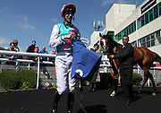 Jockey George Baker with Marmot in the winner's enclosure for the 3.20 race at Brighton Racecourse, Brighton & Hove, United Kingdom on 10 June 2015. Photo by Bennett Dean.