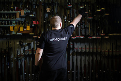 © Licensed to London News Pictures . 13/06/2019. Manchester , UK . The police armourer in front of a wall of 185 recovered weapons . Inside Greater Manchester Police's weapons store at Claytonbrook in Openshaw where police issue firearms and recovered weapons are held . Photo credit : Joel Goodman/LNP