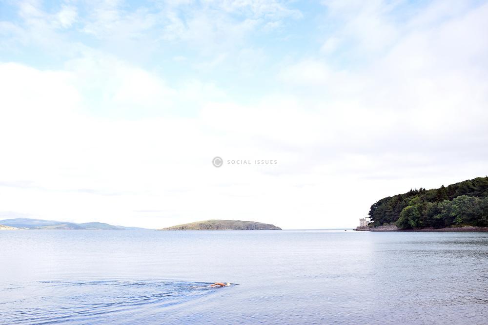 Woman swimming in Balcary Bay, Dumfries & Galloway, Scotland 2021