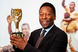 Soccer Legend Pelé with the Jules Rimet Trophy during his visit to Sheffield United Football club during celebrations of the 150th Anniversary of Sheffield Club FC the old football club in the world<br /> 8 November 2007<br /> Image COPYRIGHT Paul David Drabble