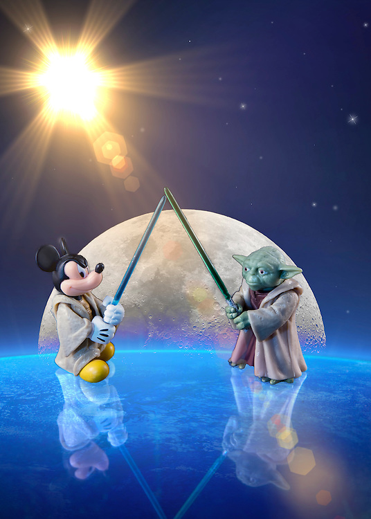 A galactic battle of Disney versus Star Wars as Mickey Mouse and Yoda Battle For For The Toon Title.<br /> <br /> Yoda is a character in the Star Wars universe, first appearing in the 1980 film Star Wars Episode V: The Empire Strikes Back. In the original films, he trains Luke Skywalker to fight against the evil Galactic Empire. In the prequel films, he serves as Grand Master of the Jedi Council and as a general in the Clone Wars.<br /> <br /> Mickey Mouse is a funny animal cartoon character created in 1928 by Walt Disney and Ub Iwerks at the Walt Disney Studios. Mickey is an anthropomorphic mouse who typically wears red shorts, large yellow shoes, and white gloves. As the official mascot of The Walt Disney Company, Mickey is one of the most recognizable cartoon characters in the world.<br /> <br /> If you're wondering what a Disney Star Wars universe looks like, look no further than The Empire Strikes Back, where everyone's favorite mouse makes an appearance in the background. Mickey Mouse can be spotted a few times on a display panel during the epic lightsaber duel between Luke Skywalker and Darth Vader. <br /> <br /> A lightsaber (or lightsabre, see spelling differences) is a weapon made popular in the Star Wars universe, a laser sword. It consists of a polished metal hilt which projects a blade of plasma about 4 feet or 1.33 meters long. The Lightsaber is the signature weapon of the Jedi order and their Sith counterparts, both of whom can use them for close combat, or to deflect blaster bolts. Its distinct appearance was created using rotoscoping for the original Star Wars films, and digitally for the prequel trilogy. The Lightsaber first appeared in the original Star Wars film (1977) and every Star Wars movie to date (except The Star Wars Holiday Special) has featured at least one Lightsaber duel