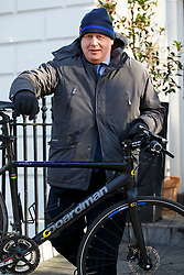 © Licensed to London News Pictures. 18/02/2016. London, UK. Mayor of London Boris Johnson leaving his house in London on Thursday, 18 February 2016. Boris Johnson still not declared which side he will support in the EU referendum. Photo credit: Tolga Akmen/LNP