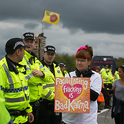 Anti-fracking  activists and protesters outside the gates of Quadrilla's fracking site June 31st, New Preston Road, Lancashire, United Kingdom. The struggle against fracking in Lancashire has been going on for years. The fracking company Quadrilla is finally ready to bring in a drill tower to start drilling and anti-frackinhg activists are waiting in front of the gates to block the equipment getting in. Fracking is a destructive and potential dangerous and highly contentious method of extracting gas and this site will be the first of many in the United Kingdom reaching miles out under ground.