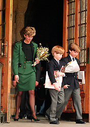 File photo dated 13/4/1992 of the Princess of Wales and her two sons Prince Harry (centre) and Prince William leaving London's Natural History Museum after visiting the new 2.4 million pound dinosaurs exhibit. Prince William returned to the museum today to open the new 78 million Darwin Centre.