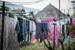"""2 March 2017, Morija, Maseru district, Lesotho: Laundry hanging to dry, at Scott Hospital. Scott Hospital is run by the Lesotho Evangelical Church in Southern Africa and is a founding member of the Christian Health Association of Lesotho. It is located in the village of Morija, and operates and supervises clinics in the Maseru District of Lesotho. Scott started out as a dispensary in 1864, and today offers comprehensive healthcare Mondays-Fridays, as well as pharmaceutical services around the clock. Lesotho suffers from high numbers in Tuberculosis in disesase and mortality, and so the hospital screens all patients for TB. The hospital observes among many patients what they describe as """"low health-seeking behaviour"""", services are increasing and demand rising, but space and human resources are a challenge, as is funding. I key concern is one of infrastructure, where the original design of the hospital matches poorly with current needs, as departments and buildings are scattered, posing a challenge for security. Another challenge is to adapt donation structures, so as to be able to receive payments electronically. The hospital has one ambulance, which they describe as not enough, but what they have. Another challenge is that lack of funds affects maintenance of buildings and infrastructure, as the immediate care of patients take priority. PLEASE NOTE: This photo is not to be used in social media."""
