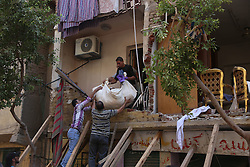 CAIRO, Sept. 7, 2016 (Xinhua) -- People take belongings out of the ruins of a collapsed house at Al-Zawya neighborhood in Cairo, Egypt on Sept. 7, 2016. Part of the building collapsed due to a gas bomb, killing one person and injuring seven. (Xinhua/Ahmed Gomaa)(yk) (Credit Image: © Ahmed Gomaa/Xinhua via ZUMA Wire)