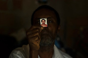 """Mr Gervásio: """"She is everything to me"""", he says while holds a 3x4 photography of his present wife, Mrs. Estelita. They live in a masonry house in Esperança Occupancy, Isidoro region. According to him, Mrs. Estelita has saved him from a deep depression state."""