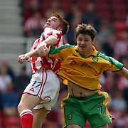 l-r; Stoke City's James O'Conner  jumps with Norwich City's Philip Mulryne