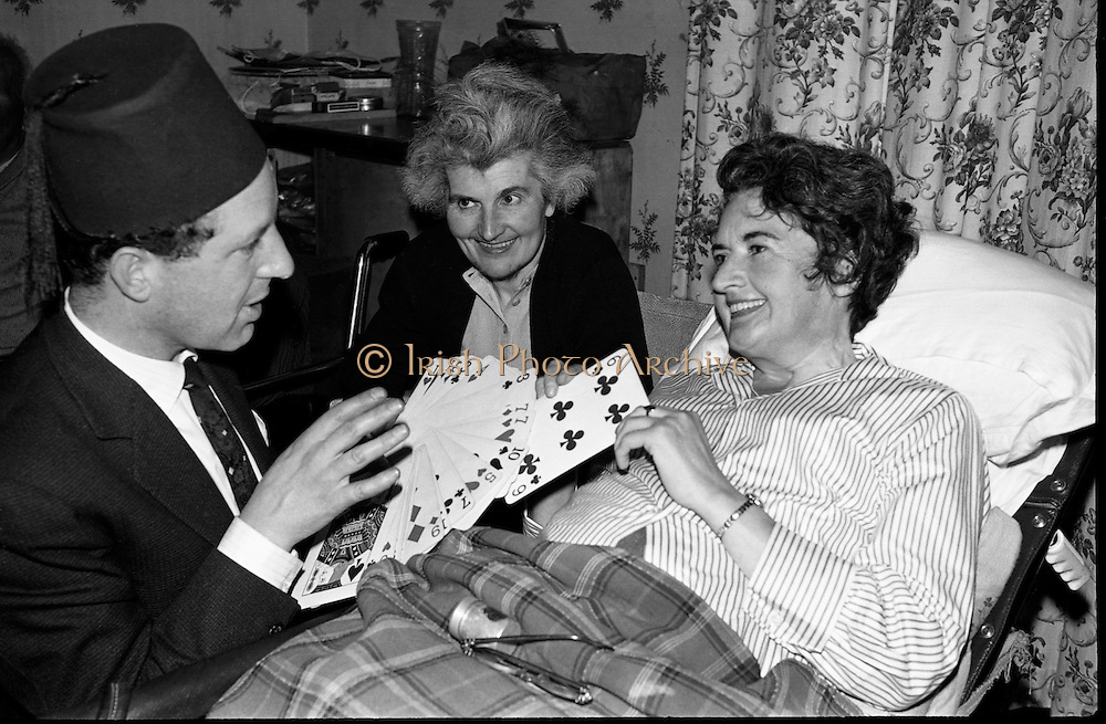 At the Cheshire Home, Shillelagh, Co. Wicklow, a variety concert featuring leading performers from Dublin was held for the entertainment of patients..Pick a card - any card! Magician Albert le Bas entertains a hospital patient..10.10.1963
