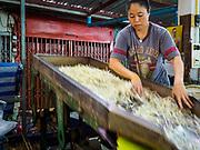 07 NOVEMBER 2017 - BANGKOK, THAILAND: Sorting bean sprouts at a local market on Ekkamai Soi 30 in Bangkok.      PHOTO BY JACK KURTZ
