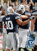 BYU tailback JJ Di Luigi (10) is congratulated by quarterback Jake Heaps, right, after scoring a touchdown against UNLV during the first half of an NCAA college football game at LaVell Edwards Stadium, Saturday, Nov. 6, 2010, in Provo, Utah.  (AP Photo/Colin E. Braley)