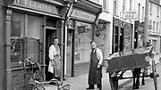 John Fleming Butcher and Andrew Hickey butchers in College Street, Killarney in 1960's.<br /> Picture by Harry MacMonagle
