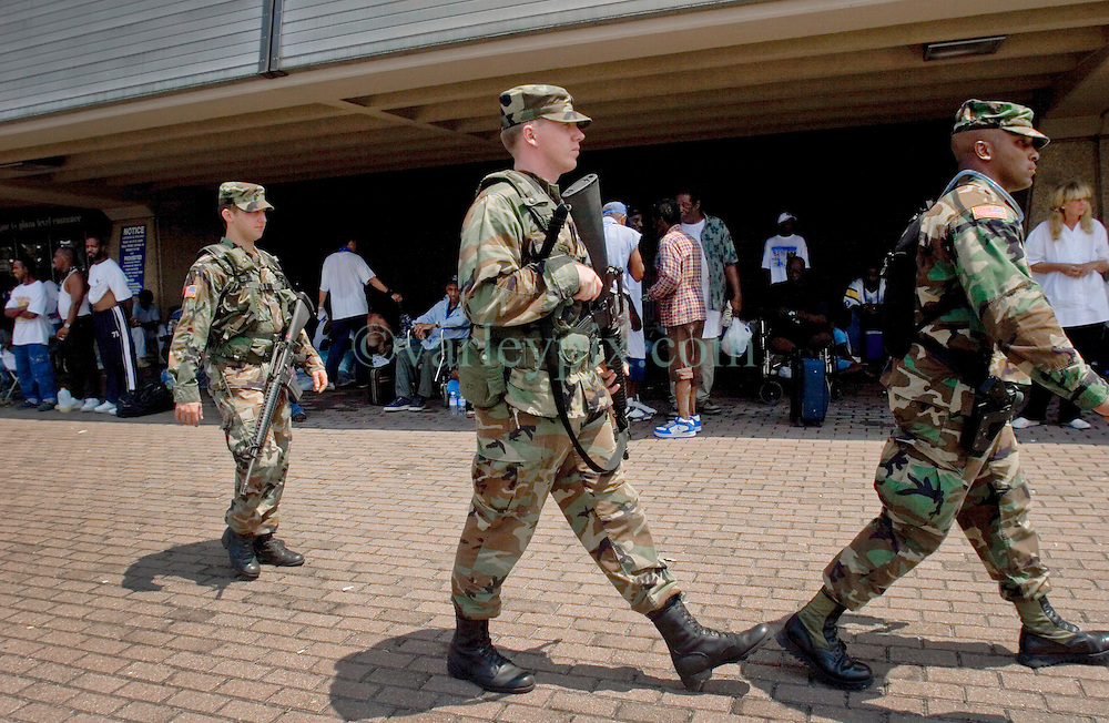 30 August, 2005. New Orleans Louisiana. Hurricane Katrina aftermath. <br /> Soldiers attempting to keep order patrol the Superdome in New Orleans where approximately 20,000 storm evacuees are housed.<br /> Photo Credit: Charlie Varley/varleypix.com