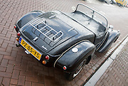 Rear view of Burton brand self-assembly kit open top car parked on street Netherlands