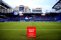 A crossing only sign pitch side at Stamford Bridge