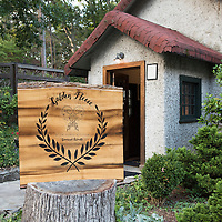 """Exterior and sign of the Golden Fleece, a Greek-inspired """"slow earth kitchen"""" restaurant run by Greek chef George Delidimos located at 111 Grovewood Road in Asheville, North Carolina."""