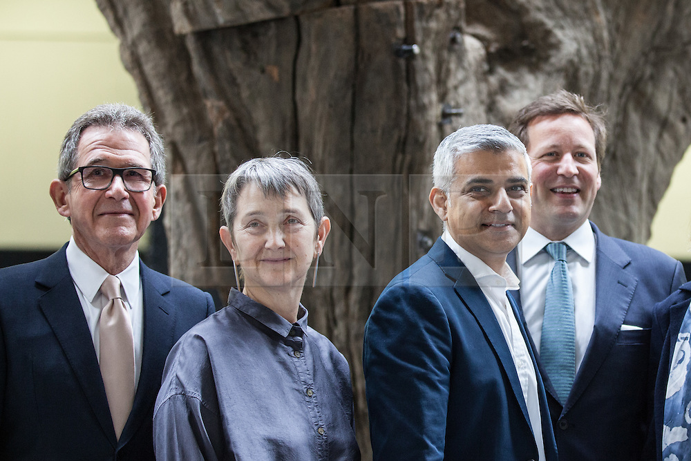© Licensed to London News Pictures. 14/06/2016. London, UK. From left: Lord Browne, former Chief Executive of BP, Frances Morris, Director of Tate Modern, Mayor of London Sadiq Khan and Ed Vaizey, Minister of State for Culture, Communications and Creative Industries, in front of Ai Wei Wei's 'Tree' in the Turbine Hall of the Tate Modern. The gallery's new ten-storey extension, the Switch House, opens to the public on Friday 17 June 2016. Photo credit: Rob Pinney/LNP