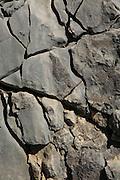 Close up weathered cracks carboniferous rock, near Tarbena, Marina Alta, Alicante province, Spain